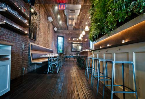 Recycled Materials Pallet Garden Wall at Colonie Restaurant